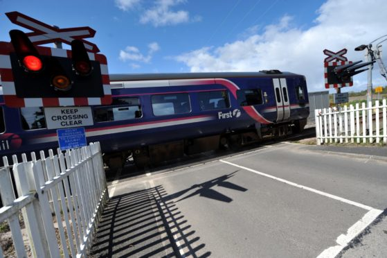 Network Rail propose to close Delny level crossing and replace it with a bridge.