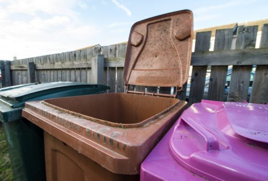 Brown bin permits could be poised to increase in Moray while a temporary reduction in blue and pink bin collections could become permanent.