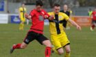 Wick Academy boss Gary Manson, right, was in action against Bo'ness United on Tuesday night.