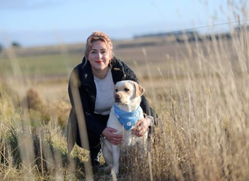Vickie Robson, pictured with her dog Daisy, is a life coach and EFT specialist.
