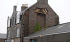 Masonry has fallen from one of the buildings on Hollybank Place. Picture by Kath Flannery