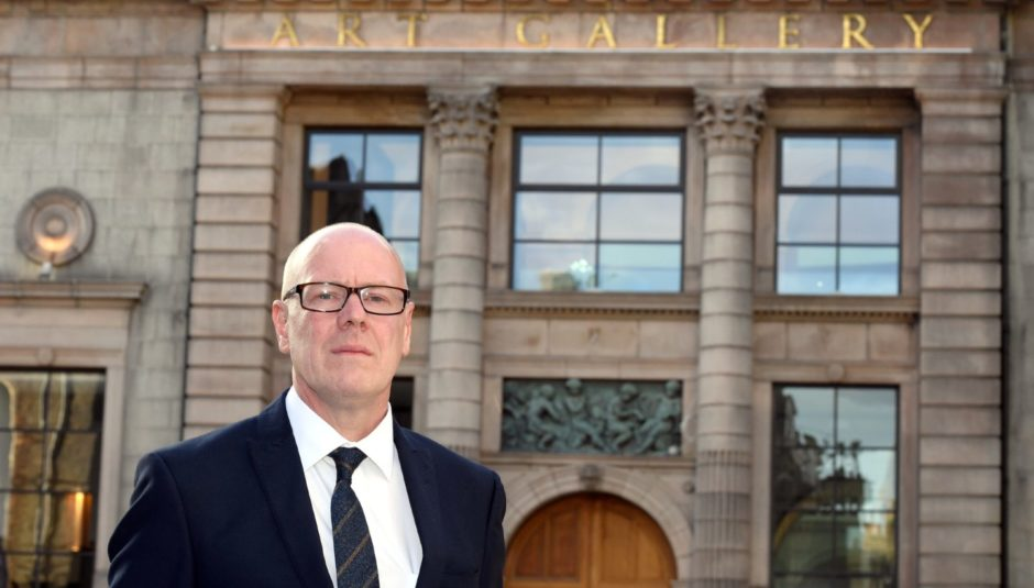 Aberdeen Central MSP, Kevin Stewart, outside Aberdeen Art Gallery, a building now with the same A listed status as the eight flat blocks