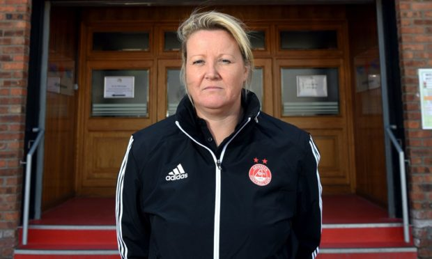 Emma Hunter outside Aberdeen's home ground of Pittodrie.