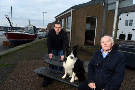 Moray MP Douglas Ross with John Mains who was part of the group behind the Burghead harbour shelter committee and his Collie Marsh.