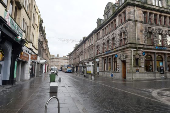 5th January 2021. Covid-19 Lockdown begins anew in the Highlands. The streets of Inverness city centre almost deserted as shoppers head the lockdown rules. Picture by SANDY McCOOK