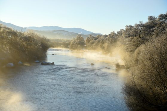 Hoare frost and steam rise from the River Spey at Boad of Garten.
