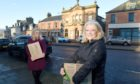 Highland councillors Maxine Smith and Pauline Munro helping with food distribution in the Alness and Invergordon.