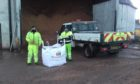 William Blake and Mark Newlands from Moray Council's roads maintenance section leading efforts to provide additional grit to communities to ease pressure on NHS.