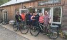 The Laggan Wolftrax team before the pandemic. Duncan Bailey of the Wee Bike Hub is on the far left, with development manager Cristiano Pizarro next to him.