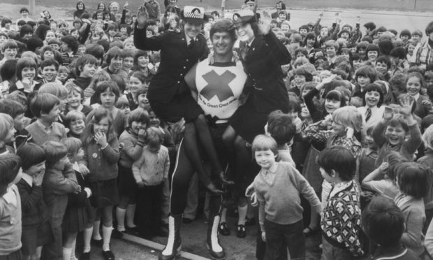 Grampian Police cadets Moira Marshall and June Duncan got a lift from Green Cross Code man Dave Prowse in Ma  1977 when he visited Dyce Primary School to spread the road safety message.