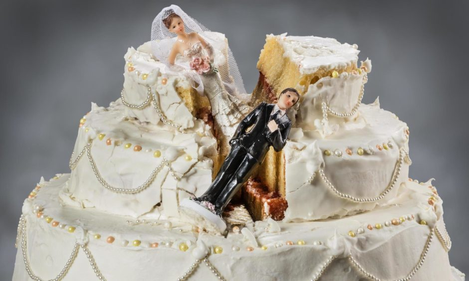 Bride and groom figurines collapsed at ruined wedding cake  Spouses always seem to struggle to keep their relationship alive; Shutterstock ID 292107500; Purchase Order: Apollo food and drink; Job: Aunt Kate ; d4a9a53f-16ed-471b-a360-5dfd56b0c159