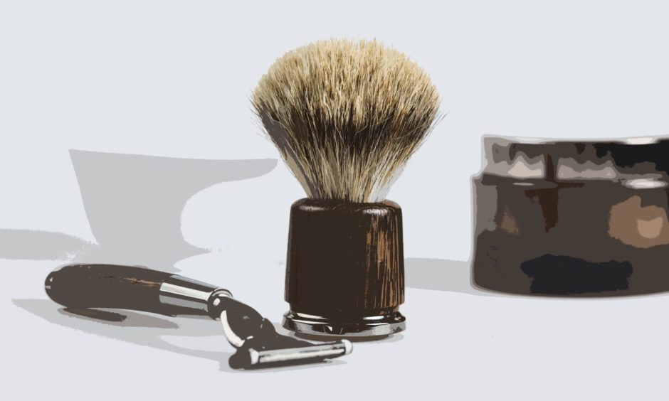 Shaving tools are displayed with a bottle of shaving cream and a cup containing of soap. / Shaving tools.; Shutterstock ID 621199163