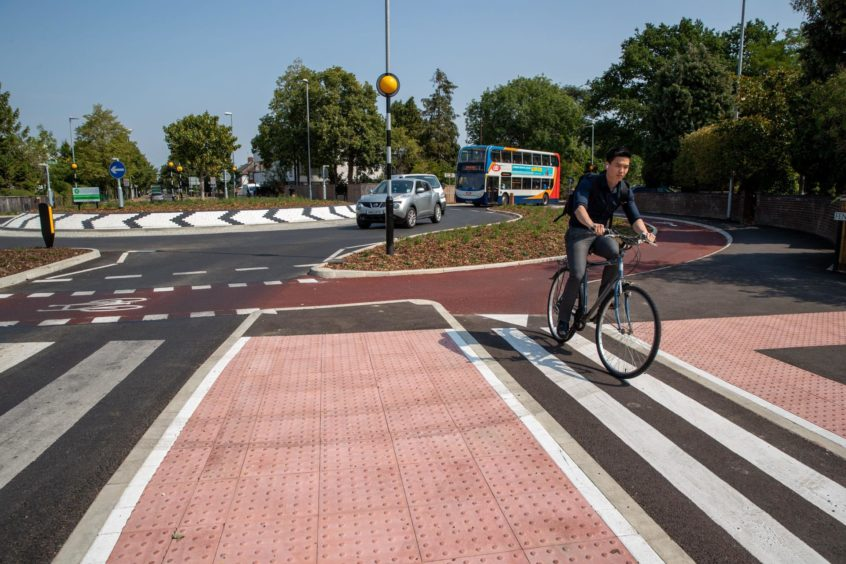 A cyclist on the UK's first Dutch-style roundabout, opened in Cambridge last year.