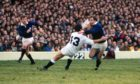 Mandatory Credit: Photo by Colorsport/Shutterstock (3166030a) Rugby Union - 1983 Five Nations Championship - England 12 Scotland 22 First in sequence: Scotland's Roy Laidlaw evades the tackle of Huw Davies (#13) on the way to scoring his suberb solo try at Twickenham 05/03/1983 5N 1983: England 12 Scotland 22 Sport