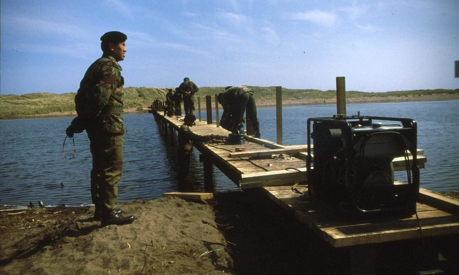 The bridge over the salt marsh at St Cyrus National Nature Reserve takes shape in 1985, courtesy of Gurkha engineers.