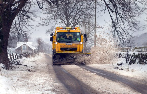 Council snow plough in action in a previous winter