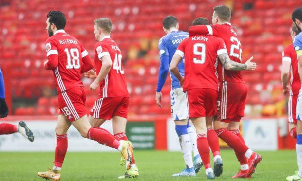 Aberdeen's Callum Hendry is congratulated by Florian Kamberi.