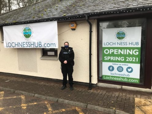 A police officer is pictured outside the vandalised toilets in Drumnadrochit.