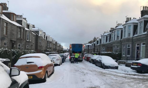 Bin collections continued in Aberdeen yesterday morning, despite staff claiming roads were too dangerous.