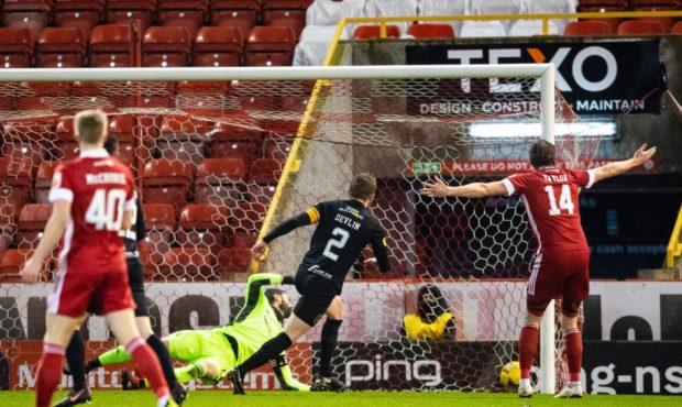 Nicky Devlin heads Livingston into a 2-0 lead against Aberdeen in February.