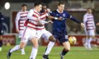 Hamilton's Reegan Minmaugh and Hakeen Odoffin (centre) battle with Ross County's Jordan White.