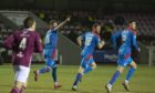 Shane Sutherland celebrates his equaliser for Caley Thistle.