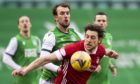 Aberdeen's Ash Taylor competes with Christian Doidge during the Scottish Premiership match against Hibernian.