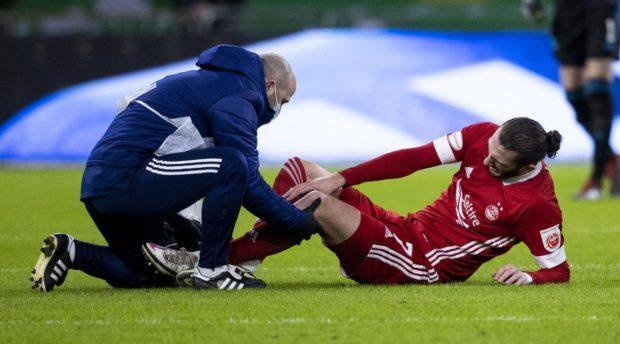 Aberdeen's Fraser Hornby receives treatment.