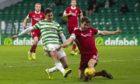 Aberdeen defender Tommie Hoban challenges Patryk Klimala.