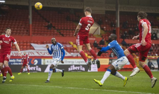 Callum Hendry heads in Aberdeen's first goal in seven games.