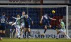 Ross County striker Jordan White heads home the winner against Celtic.