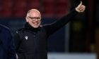 Ross County manager John Hughes celebrates a famous win against Celtic.