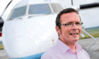 Managing director of Highlands and Islands Airports Inglis Lyon at Inverness Airport.