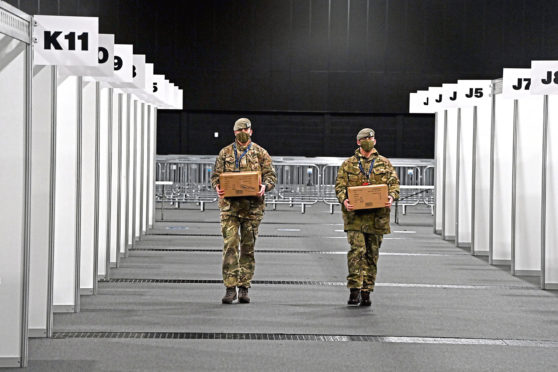 Royal Scots Dragoon Guards help to set the stage for the mass vaccination centre 'show' at the P&J Live arena