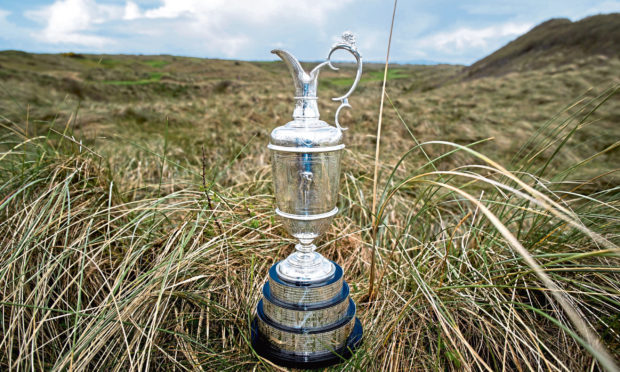 File photo dated 02-04-2019 of A general view of the 18th hole with The Claret Jug at Royal Portrush Golf Club, Northern Ireland.  PA Photo. Issue date: Thursday April 2, 2020. The 149th Open Championship, due to be played at Royal St George's in July, has been cancelled, organisers have announced. See PA story SPORT Coronavirus. Photo credit should read Liam McBurney/PA Wire.
