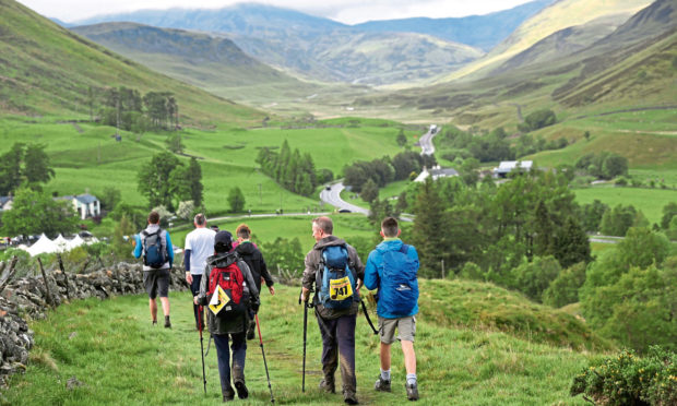 Gayle's team yomps down to the Spittal of Glenshee in 2017.