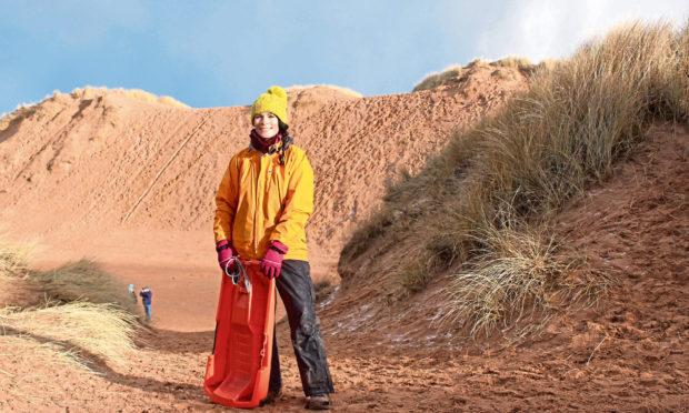 Gayle goes sledging on dunes at Balmedie Beach in Aberdeenshire.