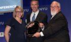 Arne Sorenson, centre, received an award from Jonathan M. Tisch Center of Hospitality, New York University.