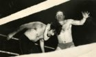 George Kidd wrestles Ivor Penzekoff at Caird Hall, Dundee, in January 1965.