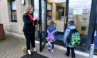 First day back at Laurencekirk Primary School pupils. Pictured is Head Teacher of Laurencekirk Primary School Jill Smith meeting pupils.