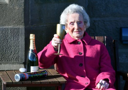 Catherine raises a glass on her 105th birthday
