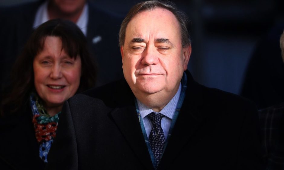 PICTURE ADVISORY. Editors of newspapers printed or that have editions circulating in Scotland and all Internet subscribers or broadcasters whose content is visible in Scotland are advised to seek legal advice before publication of this photograph as, under Scottish Law, the use of a picture of an untried person may be held to be in Contempt of Court. Former Scottish first minister Alex Salmond arrives at the High Court in Edinburgh for the tenth day of his trial over accusations of sexual assault, including one of attempted rape. PA Photo. Picture date: Friday March 20, 2020. See PA story COURTS Salmond. Photo credit should read: Andrew Milligan/PA Wire