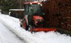 Heavy snow in Aboyne. An amber weather warning covers central, Tayside and Fife, Grampian, the Highlands and Islands and Argyll and Bute.