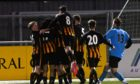 The Huntly players celebrate their success against Cumbernauld in the first round of the Scottish Cup