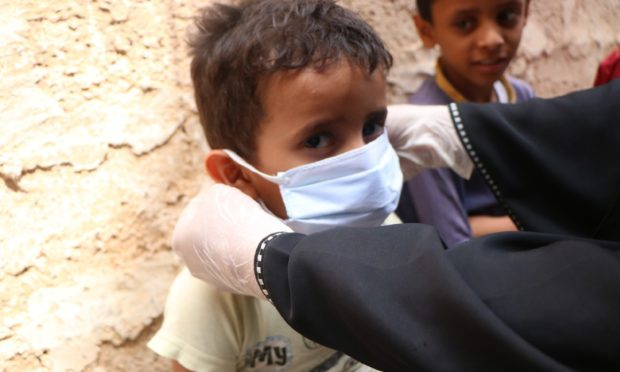 Child wearing mask in Yemen.  Disasters Emergency Committee (DEC)  Submitted 28/02/21   Covid-19 pandemic pushing fragile countries toward 'catastrophe' as cases and deaths go 'chronically underreported'  Image from  - Community health volunteer teach kids how to wash hands and practice good hygiene to stay healthy
