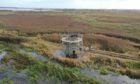 The remains of the 18th century windpump at Loch of Strathbeg has been refurbished in a major new heritage project.  Supplied by RSPB. Photograph by Richard Humpidge.