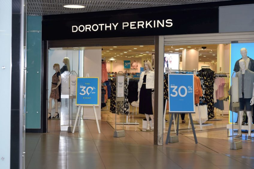 Dorothy Perkins, pictured, will move to an online only future under Boohoo, along with Burton and Wallis, after a £25m deal was stuck