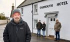Campaigners in Garmouth are considering a community buyout of the local hotel. Pictured front: Roddy Robertson, chairman of Garmouth and Kingston Amenities Association, with Fiona and Nick Walklet and Nick Adamson.