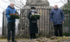 GLENCOE MASSACRE  George Roy (left) and Rios MacDonald of the Glencoe Heritage Trust prepare to lay wreaths at the monument to victims of the Glencoe massacre after George Grant also of Trust gave a short reading. Photograph and words Iain Ferguson, The Write Image; d31a4ef1-1f2a-4bb7-b097-f849984e1401