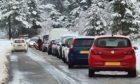 Cars creating log jams at Glenmore.